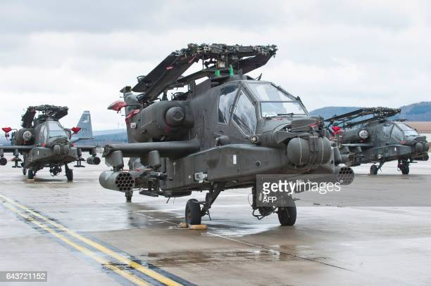 Apache attack helicopters of the US Army stand on the tarmac after arriving at the US Air Base in Ramstein western Germany on February 22 2017 The...