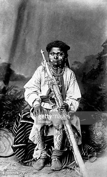 Apache boy with face and legs painted.   Location: photography studio.