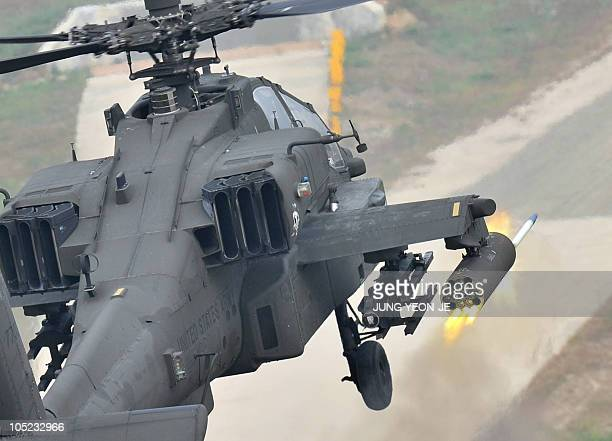 Apache helicopter fires rockets during a joint gunnery exercise at a military firing range in Pocheon near the heavilyfortified border with North...