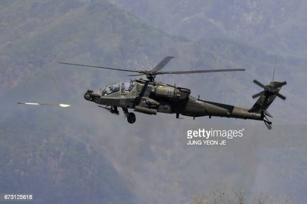 Apache helicopter fires rockets during a joint live firing drill between South Korea and the US at the Seungjin Fire Training Field in Pocheon 65 kms...