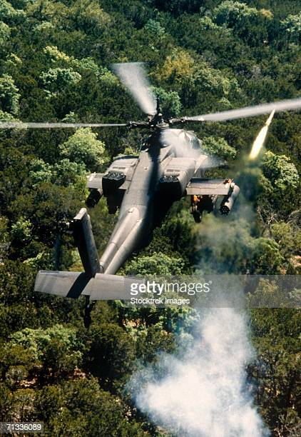 apache helicopter firing missiles - apache helicopter stock pictures, royalty-free photos & images
