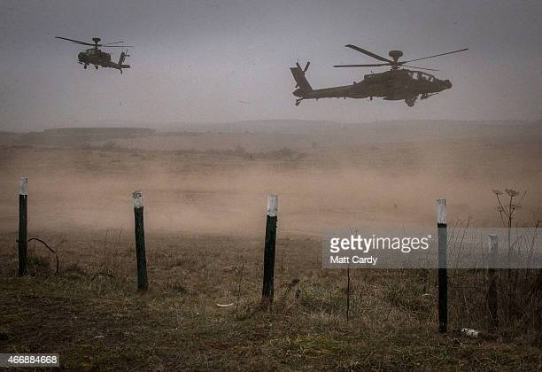Apache helicopter kicks up dust during Exercise Tractable on March 19 2015 in Salisbury England The threeweek major exercise involving hundreds of...
