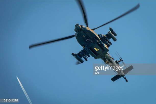 "apache helicopter of the royal netherlands air force flying low over the tree line - ""sjoerd van der wal"" or ""sjo"" stock pictures, royalty-free photos & images"