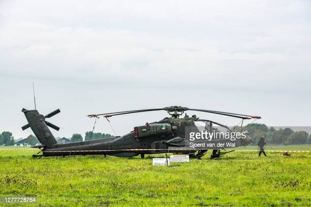 Apache helicopter of the Royal Netherlands Air Force in a meadow after an emergency landing in the evening of September 30 near the town of Elburg on...