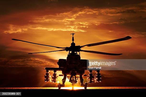 ah-64a apache helicopter, silhouette - apache helicopter stock pictures, royalty-free photos & images