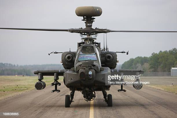 AH-64 Apache helicopter sits on the runway during flight operations, Conroe, Texas.