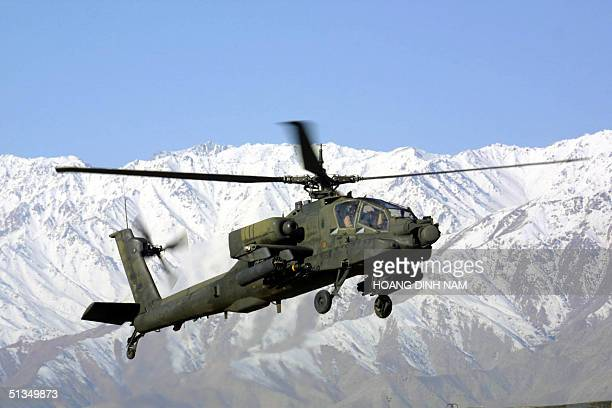 Apache helicopter takes off from a US forward desert base some 20 miles from the Gardez battlefield in Southeastern Afghanistan where the US launched...