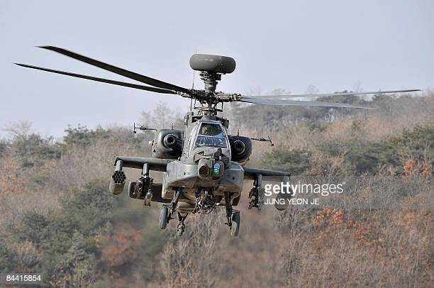 Apache helicopter takes to the air during an aerial gunnery exercise at a military firing range in Pocheon near the heavilyfortified border with...
