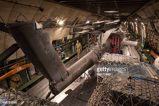 Apache helicopters are loaded inside an Antonov aircraft which has been chartered to take the aircraft back to the UK at Kandahar airfield on...