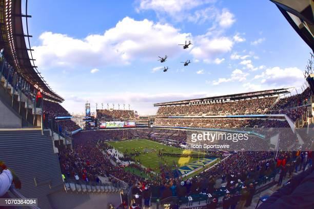 Apache helicopters fly over the stadium during the ArmyNavy game on December 8 at Lincoln Financial Field in PhiladelphiaPA