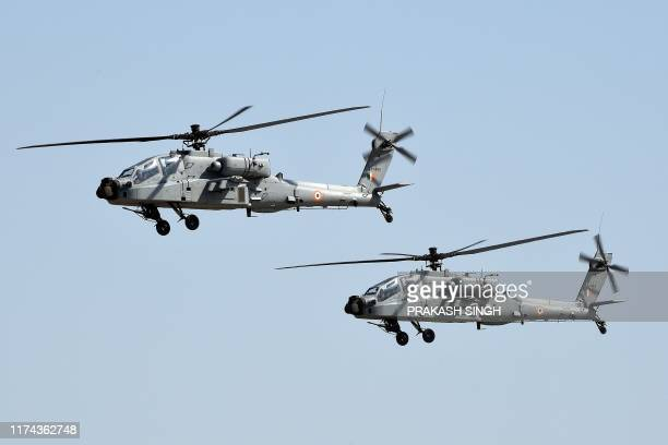 Apache helicopters fly past during the Air Force Day parade at an IAF station in Ghaziabad, on the outskirts of New Delhi, on October 8, 2019. - The...