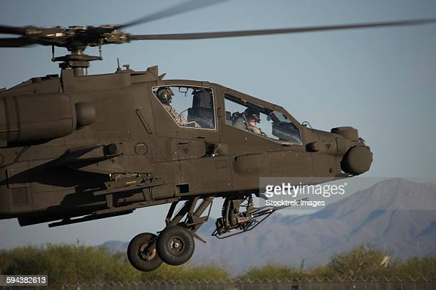 AH-64D Apache Longbow lifts off on a mission during exercise Angel Thunder 2013.