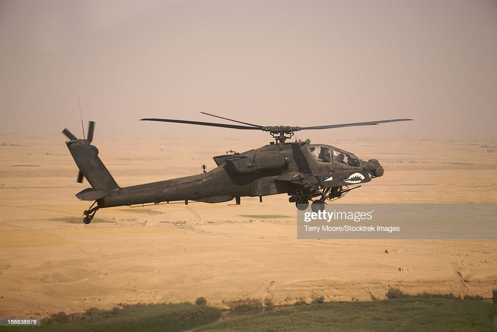 AH-64D Apache Longbow on a mission over Northern Iraq. : Stock Photo