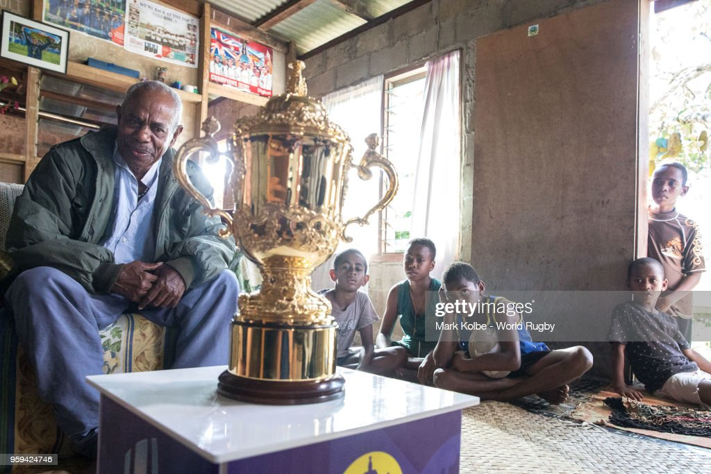 Apakuki Saisai and his family and friends sit with the Webb Ellis Cup in his house during Rugby World Cup 2019 Trophy Tour on May 17, 2018 in Galoa village, Fiji.