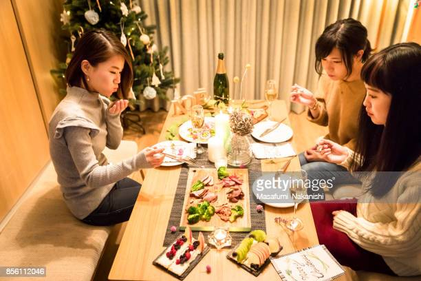 apanese girls enjoying a christmas dinner party - only japanese stock pictures, royalty-free photos & images