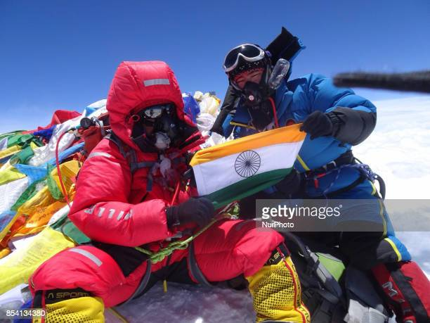 IPS Aparna kumar holds indian tricolor flag after successful summit of mount Manasalu of nepalese himalayas She is the first ever woman from India to...