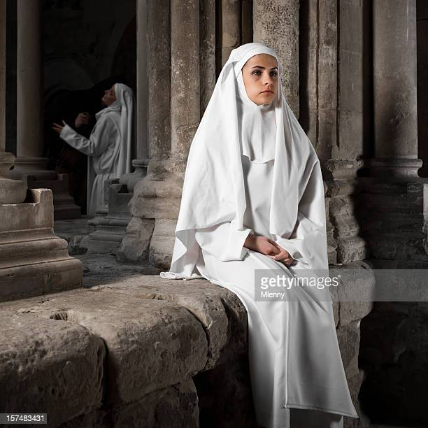 apart. lonely nun. - nun stock photos and pictures