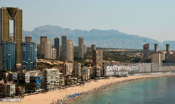 Apartament blocks are pictured along the beach of the seaside resort of Benidorm on August 5 2018 Europe sweltered through an intense heatwave today...