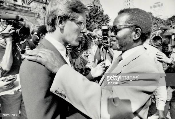 Apartheid fighter Tambo encouraged by Rae South African black leader Oliver Tambo greets New Democratic Party leader Bob Rae at a Queen's Park rally...