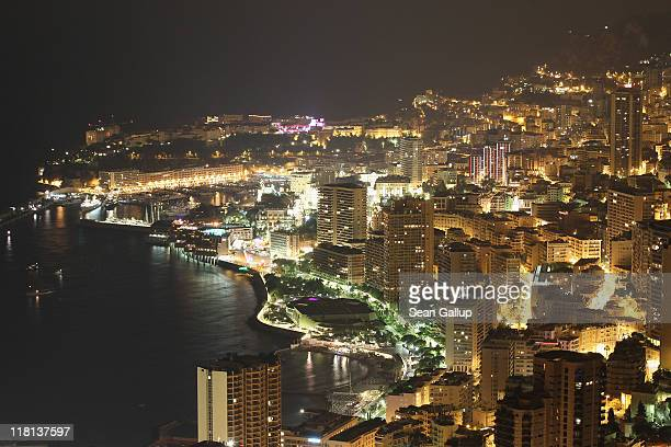 Apartment and office buildings stand crowded together and illuminated at night on July 2 2011 in Monaco Monaco Monaco a principality ruled by Prince...