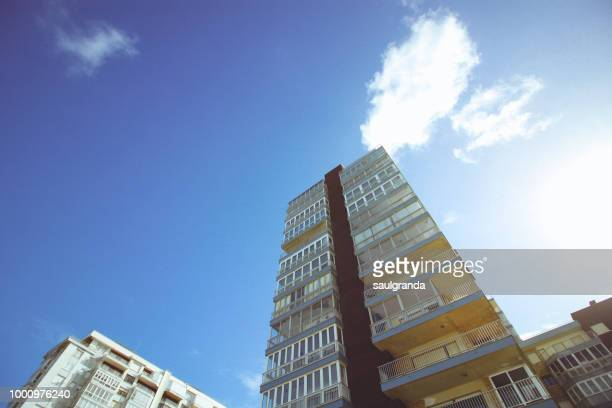 Apartment blocks against blue sky, low angle view
