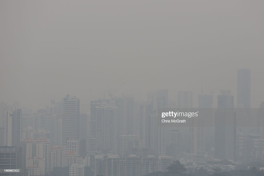 Apartment blocks are seen covered in smoke haze on April 19, 2013 in Singapore. The haze was created by burning off in neighbouring Sumatra and caused the Pollutant Standards Index to rise, hovering between 28 and 43.