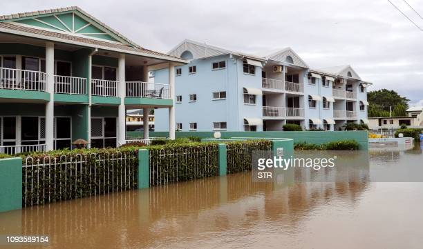 Apartment blocks sit in Townsville's floodwaters on February 4 as the recent downpour in Australia's tropical north has seen some areas get a year's...