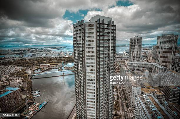 apartment building by the river - nee nee stock photos and pictures