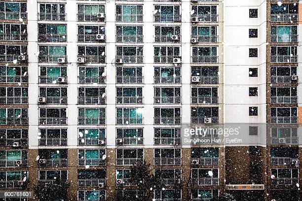 Apartment Building In City During Blizzards