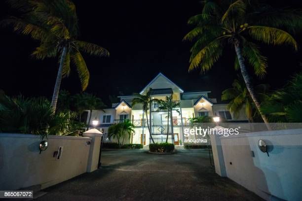 apartment building in grace bay at night, turks and caicos - grand bahama stock photos and pictures