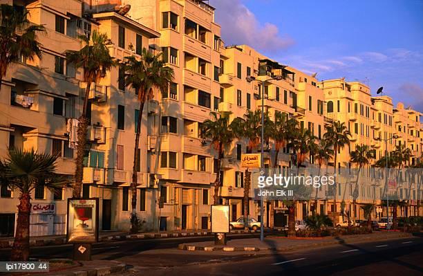 apartment buildings along el corniche, alexandria, egypt - alexandria stock pictures, royalty-free photos & images