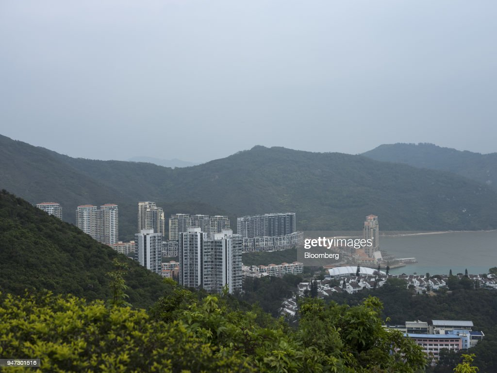 Apartment buildings and low-rise units stand in Discovery Bay, a residential project developed by Hong Kong Resort Co., on Lantau Island in Hong Kong, China, on Tuesday, March 27, 2018. Private homes in Discovery Bay currently sell from about HK$8 million to HK$80 million, said Denis Ma, head of research for Hong Kong at real-estate services company Jones Lang LaSalle Ltd. Photographer: Justin Chin/Bloomberg via Getty Images