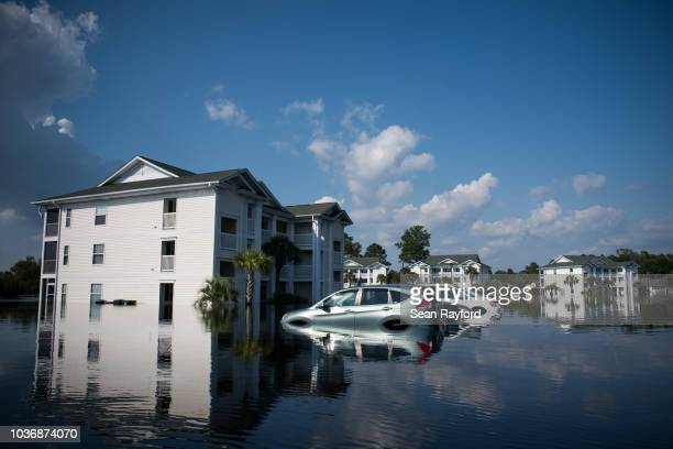 Apartment buildings at Aberdeen Country Club are inundated by floodwaters caused by Hurricane Florence on September 20, 2018 in Longs, South...