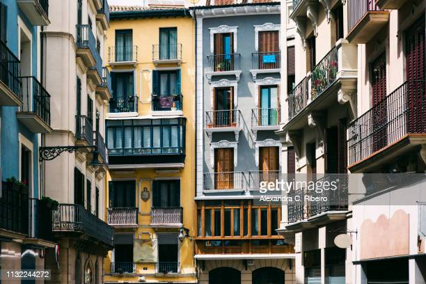 apartment buildings in pamplona, spain - pamplona stock photos and pictures