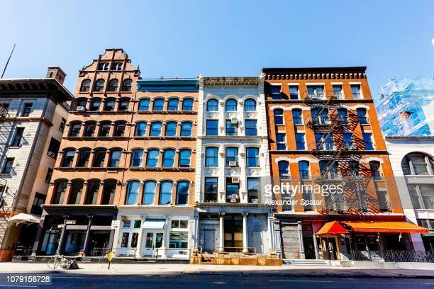 apartment buildings in soho neighbourhood, new york city, usa - soho new york stock photos and pictures