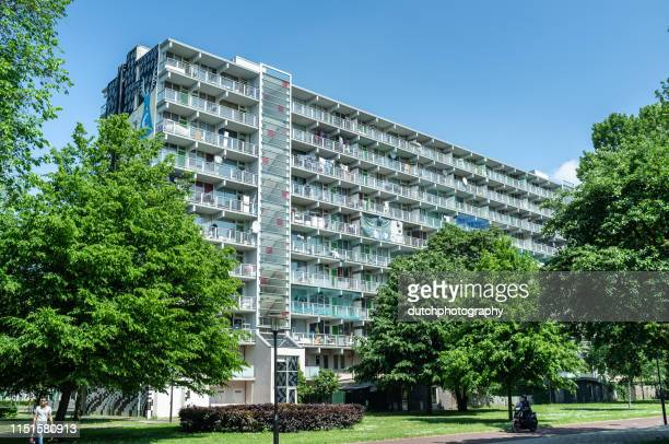 apartment buildings in the amsterdam bijlmer. - flat stock pictures, royalty-free photos & images
