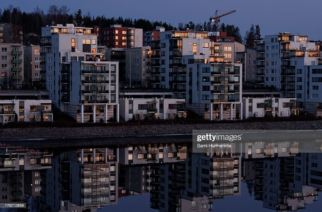 Apartment buildings lit by the setting sun : Stock Photo