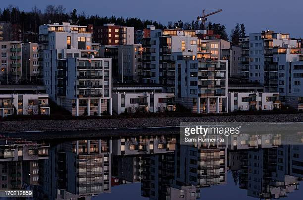 apartment buildings lit by the setting sun - jyväskylä stock pictures, royalty-free photos & images