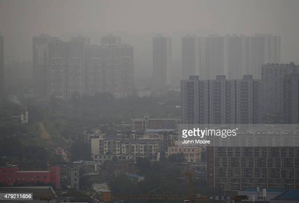 Apartment buildings rise into the smog filled skyline June 30 2015 in Chengdu China First inhabited more than 4 thousand years ago Chengdu now has...