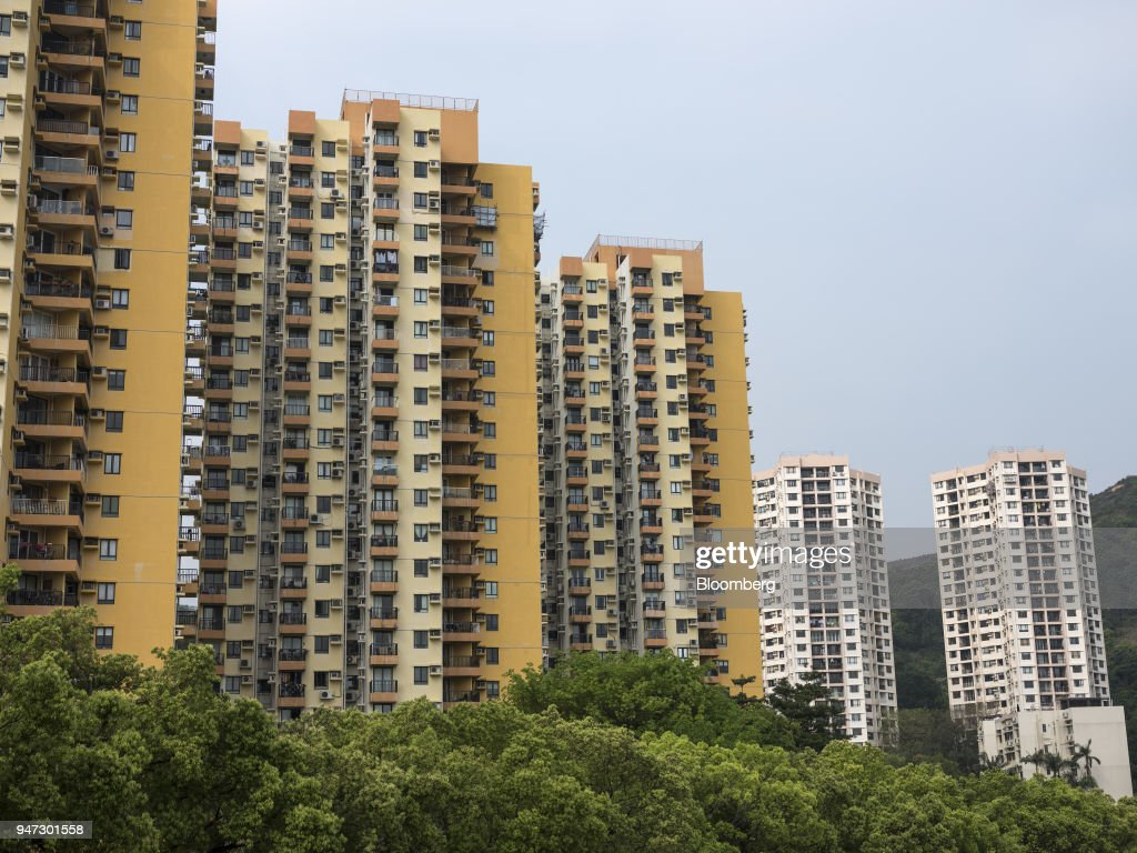 Apartment buildings stand in Discovery Bay, a residential project developed by Hong Kong Resort Co., on Lantau Island in Hong Kong, China, on Tuesday, March 27, 2018. Private homes in Discovery Bay currently sell from about HK$8 million to HK$80 million, said Denis Ma, head of research for Hong Kong at real-estate services company Jones Lang LaSalle Ltd. Photographer: Justin Chin/Bloomberg via Getty Images