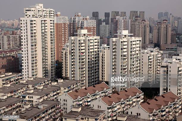 Apartment buildings stand in Shanghai China on Monday Jan 17 2011 Shanghai China's financial center will this year prepare for a trial property tax...