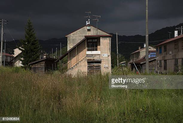 Apartment buildings stand in Yubari Hokkaido Japan on Thursday July 21 2016 Yubari a former coalmining town in northern Japan is taking unprecedented...