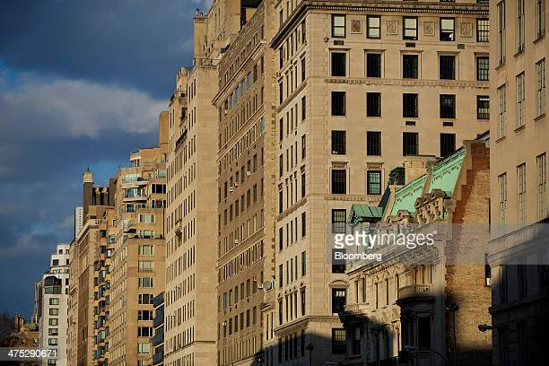 Apartment buildings stand on the Upper East Side neighborhood of New York US on Tuesday Feb 25 2014 Home prices in the US climbed at a slower pace in...