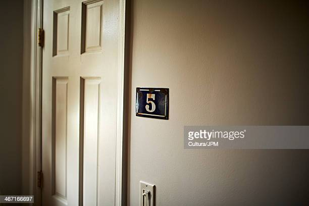 Apartment door with number 5