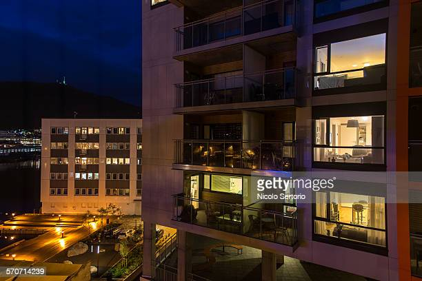 apartment lights at night - apartment balcony stock pictures, royalty-free photos & images