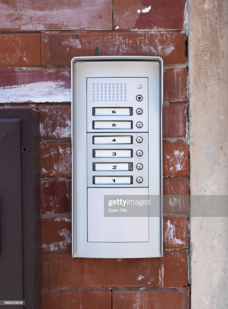 Apartment Numbers And Push On Door Buzzer Stock Photo