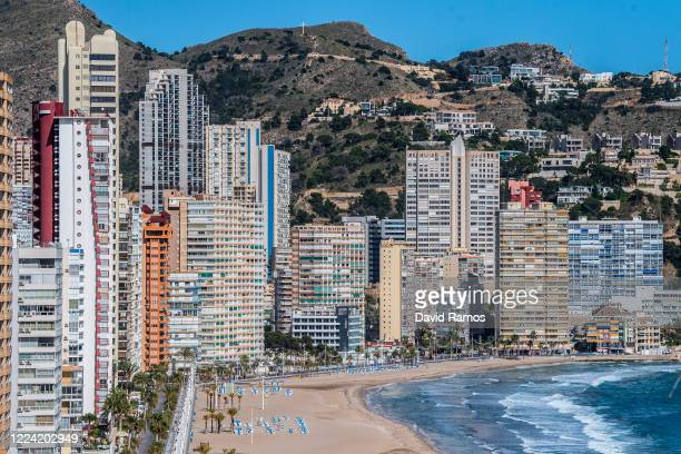 Apartment towers sit along the promenade of the closed Playa de Levante Beach on May 11 2020 in Benidorm Spain Some parts of Spain have entered the...