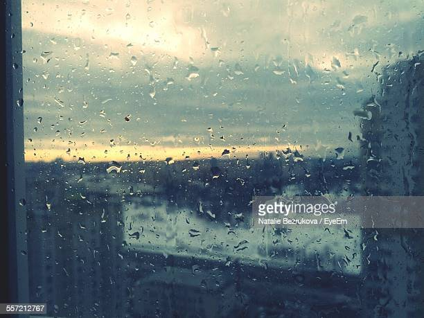 Apartment Viewed Through Window In Rainy Season