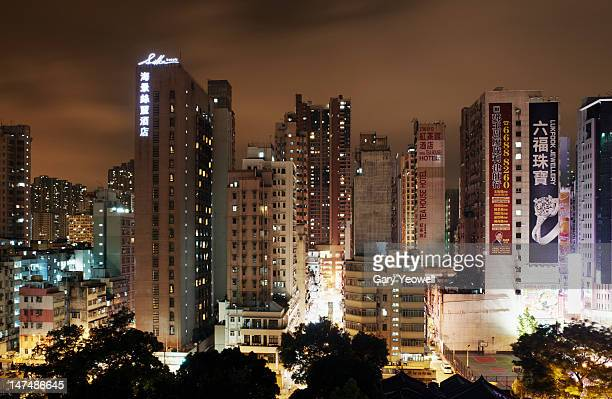 apartments and skyscrapers at night - yeowell stock photos and pictures
