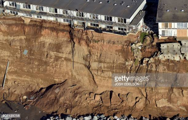 Apartments are seen at the edge of an eroding cliff in Pacifica California on January 27 2016 Storms and powerful waves caused by El Nino have been...